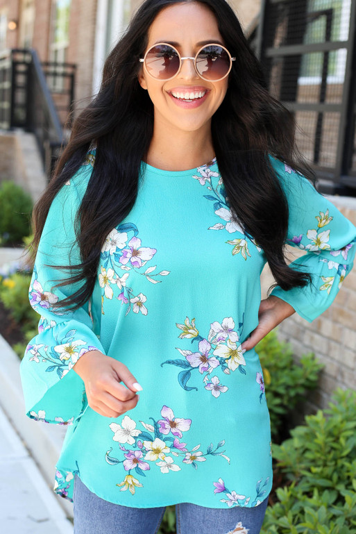 Model wearing Mint Floral Bell Sleeve Blouse
