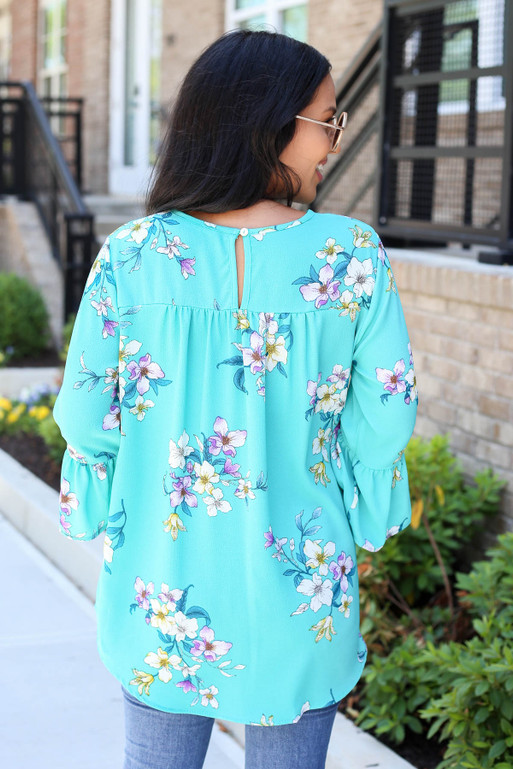 Model wearing Mint Floral Bell Sleeve Blouse Back View