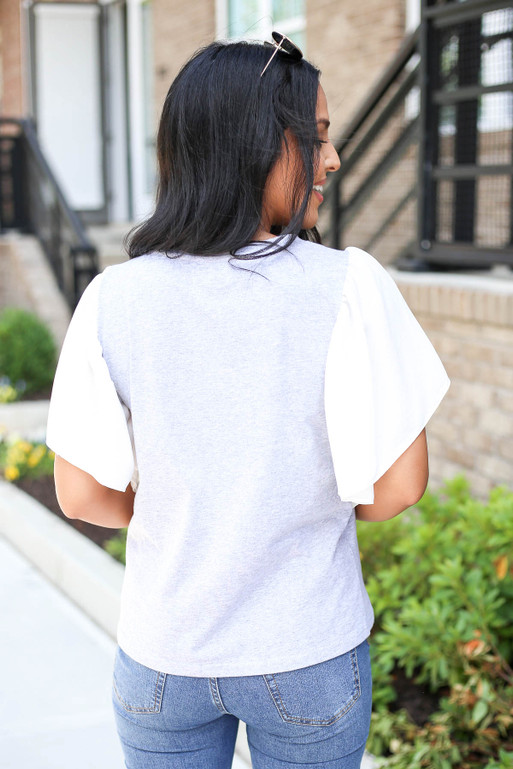 Model wearing Grey and White Flutter Sleeve Tee Back View