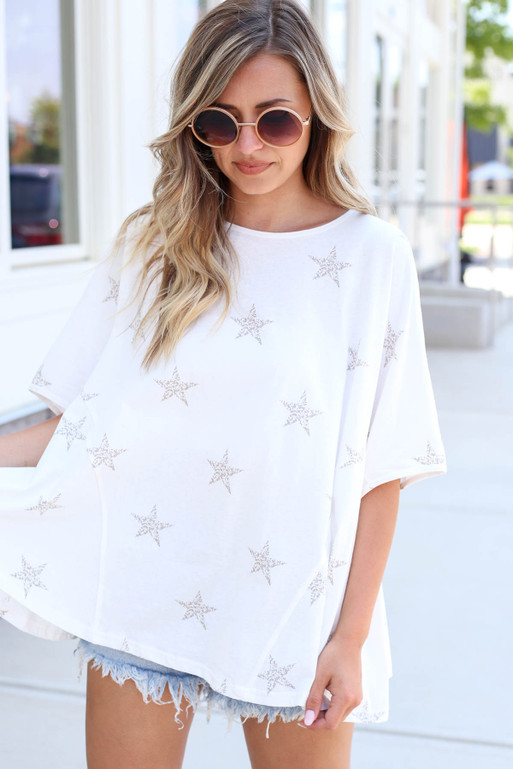 Model wearing White Oversized Star Print Tee