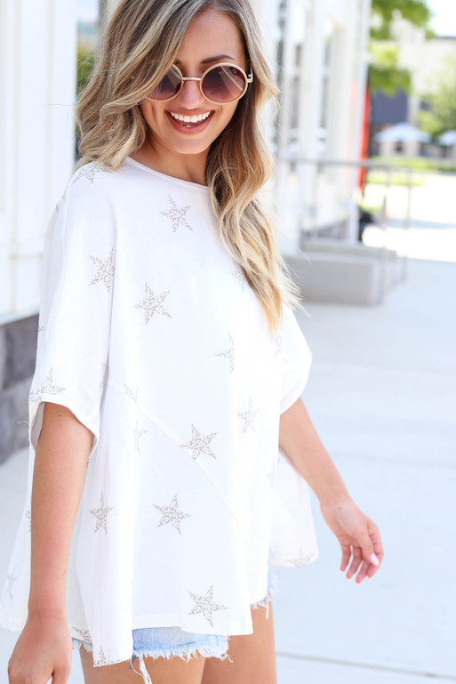 Model wearing White Oversized Star Print Tee Side View