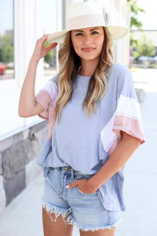 Model wearing Blue Oversized Color Block Tee Front View Tucked In