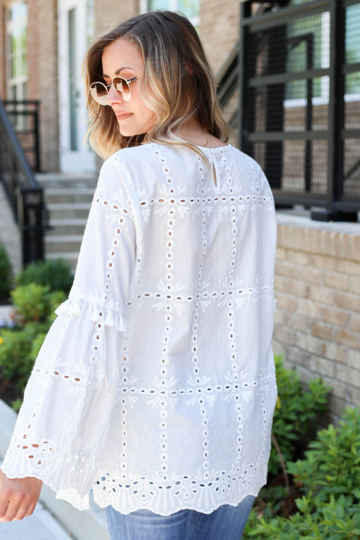Model wearing White Eyelet Bell Sleeve Blouse Back View