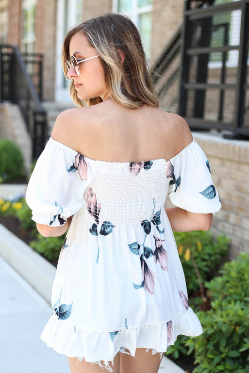Model wearing White Off the Shoulder Smocked Floral Top Back View
