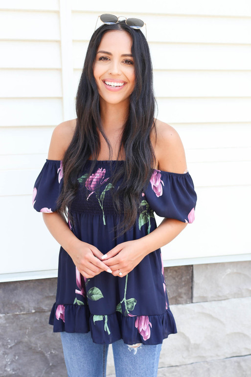 Model wearing Navy Off the Shoulder Smocked Floral Top Front View