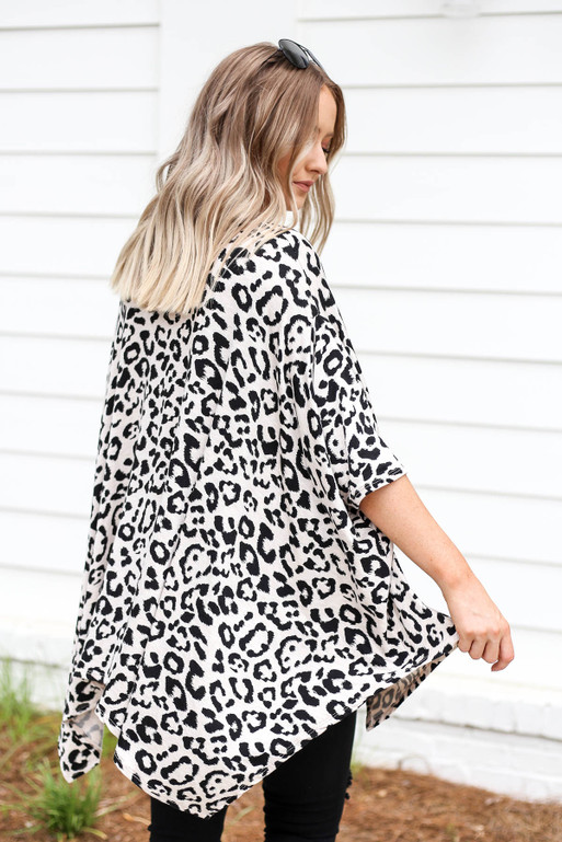 Model wearing White and Black Leopard Print Top Back View