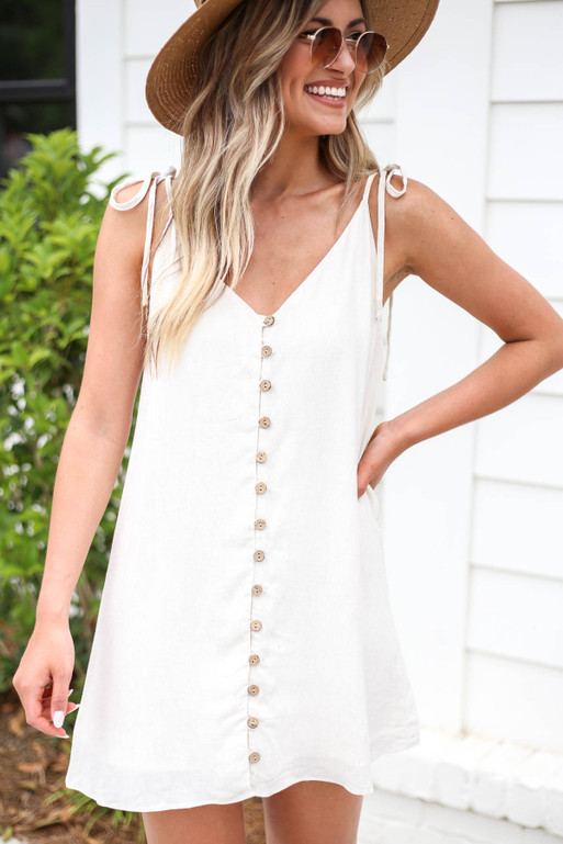 Model wearing Ivory Button Front Swing Dress Detail View