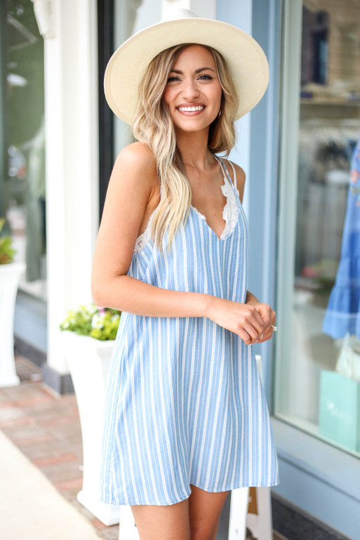 Model wearing Blue and White Striped Swing Dress Side View