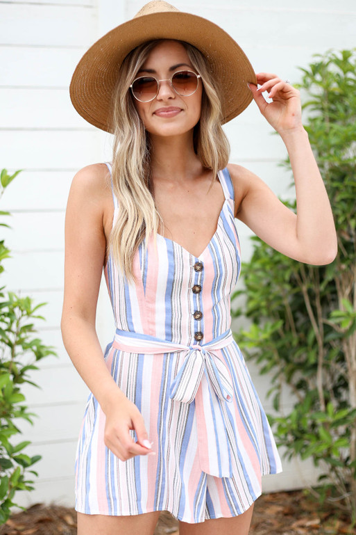 Model wearing Blush, Blue and White Striped Tie Back Romper Front View