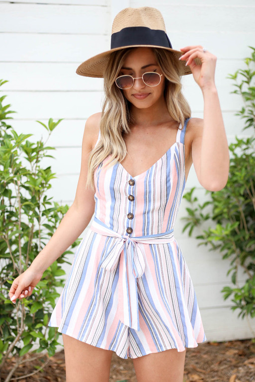 Model wearing Blush, Blue and White Striped Tie Back Romper