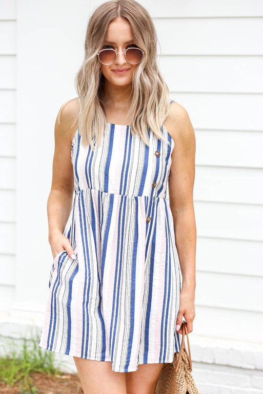 Model wearing Blue, White, and Blush Striped Button Up Dress