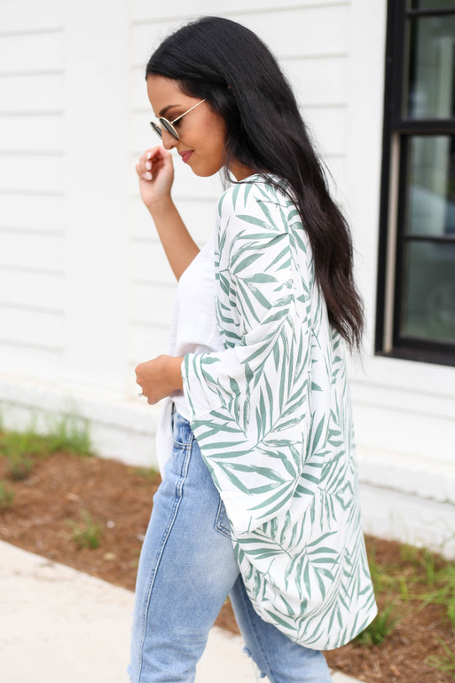 Model wearing White and Green Leaf Print Kimono Side View