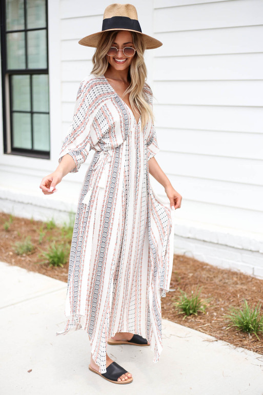 Model wearing Ivory Boho Print 3/4 Sleeve Maxi Side View