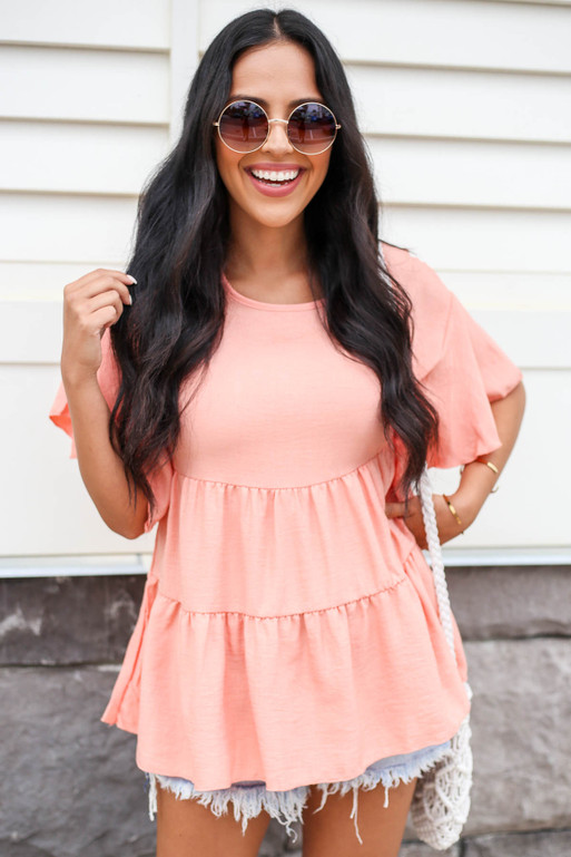 Model wearing Coral Tiered Blouse