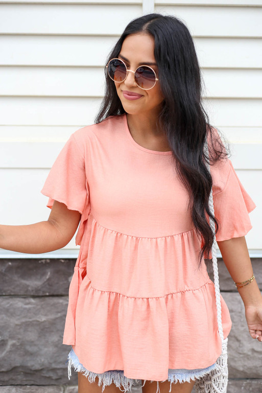 Model wearing Coral Tiered Blouse Front View
