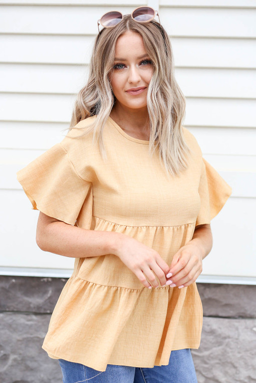 Model wearing Mustard Tiered Blouse
