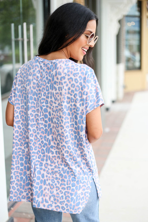Model wearing Blush and Blue Leopard Print V-Neck Tee Back View
