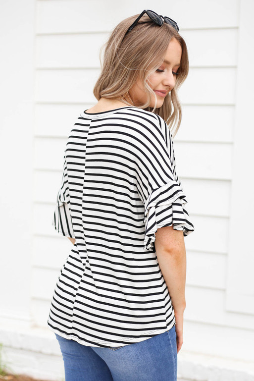 Model wearing White and Black Striped Ruffle Sleeve Tee Back View