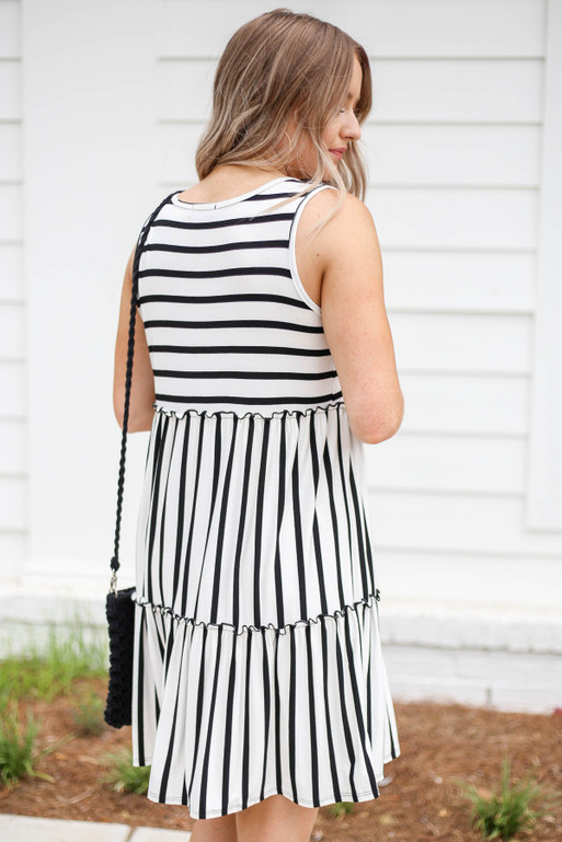Model wearing White and Black Striped Tiered Dress Back View