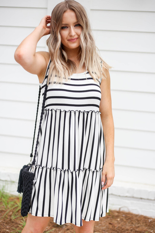 Model wearing White and Black Striped Tiered Dress Front View