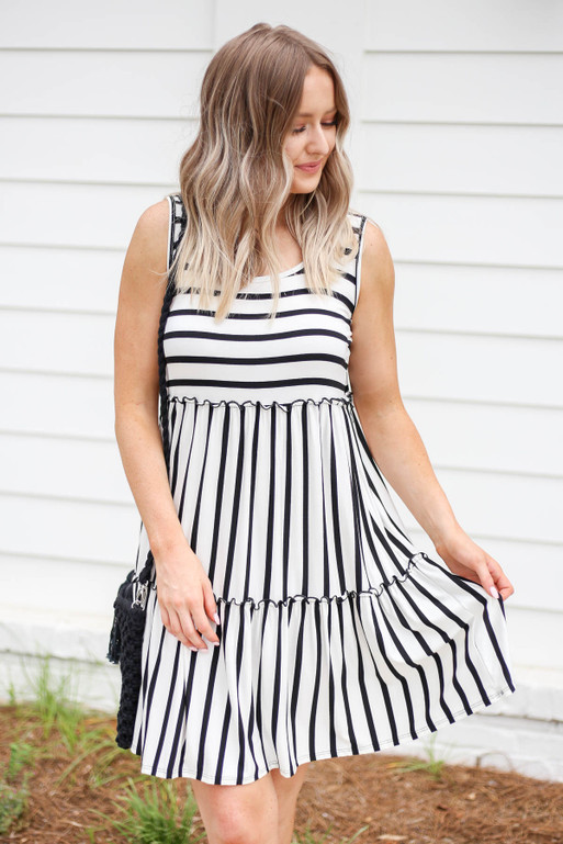 Model wearing White and Black Striped Tiered Dress