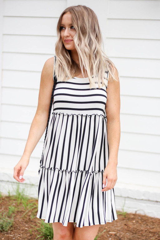Model wearing Black and White Striped Sleeveless Tiered Dress