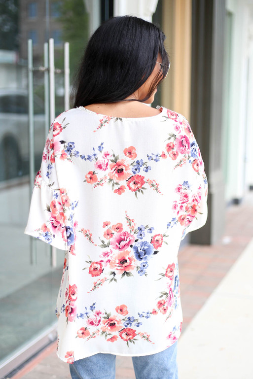 Model wearing Ivory Floral Ruffle Sleeve Top Back View