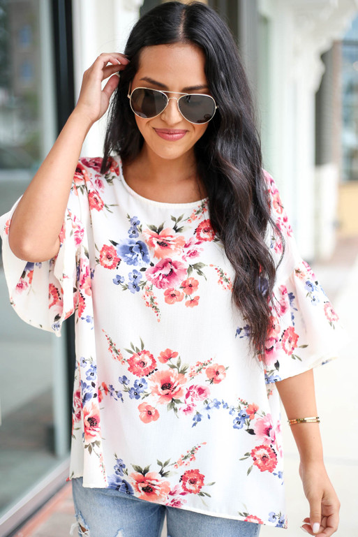Model wearing Ivory Floral Ruffle Sleeve Top