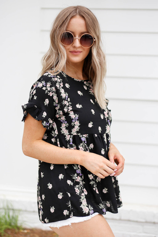 Model wearing Black Floral Ruffle Sleeve Babydoll Top Side View