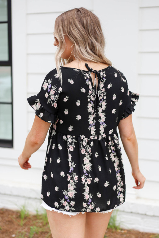 Model wearing Black Floral Ruffle Sleeve Babydoll Top Back View