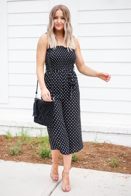 Model wearing Black Strapless Polka Dot Jumpsuit Front View