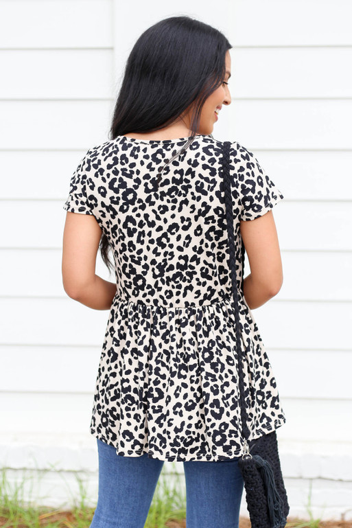 Model wearing Taupe Leopard Print Babydoll Top Back View