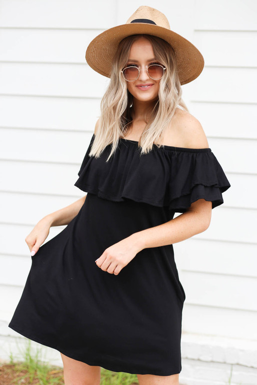 Model wearing Black Off the Shoulder Pocketed Mini Dress