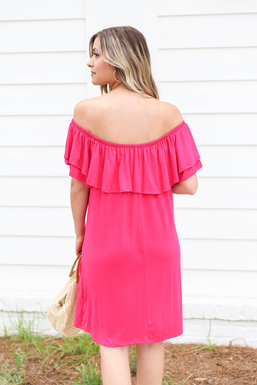 Model wearing Neon Pink Off the Shoulder Pocketed Mini Dress Back View