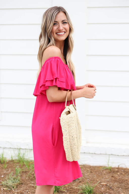 Model wearing Neon Pink Off the Shoulder Pocketed Mini Dress Side View