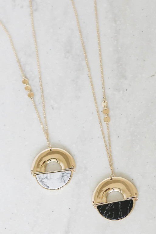 White - and Black Marble Pendant Necklaces Flay Lay