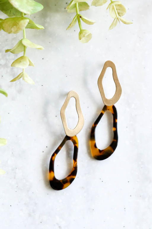 Tortoise - and Gold Acrylic Statement Earrings with Plant Flat Lay