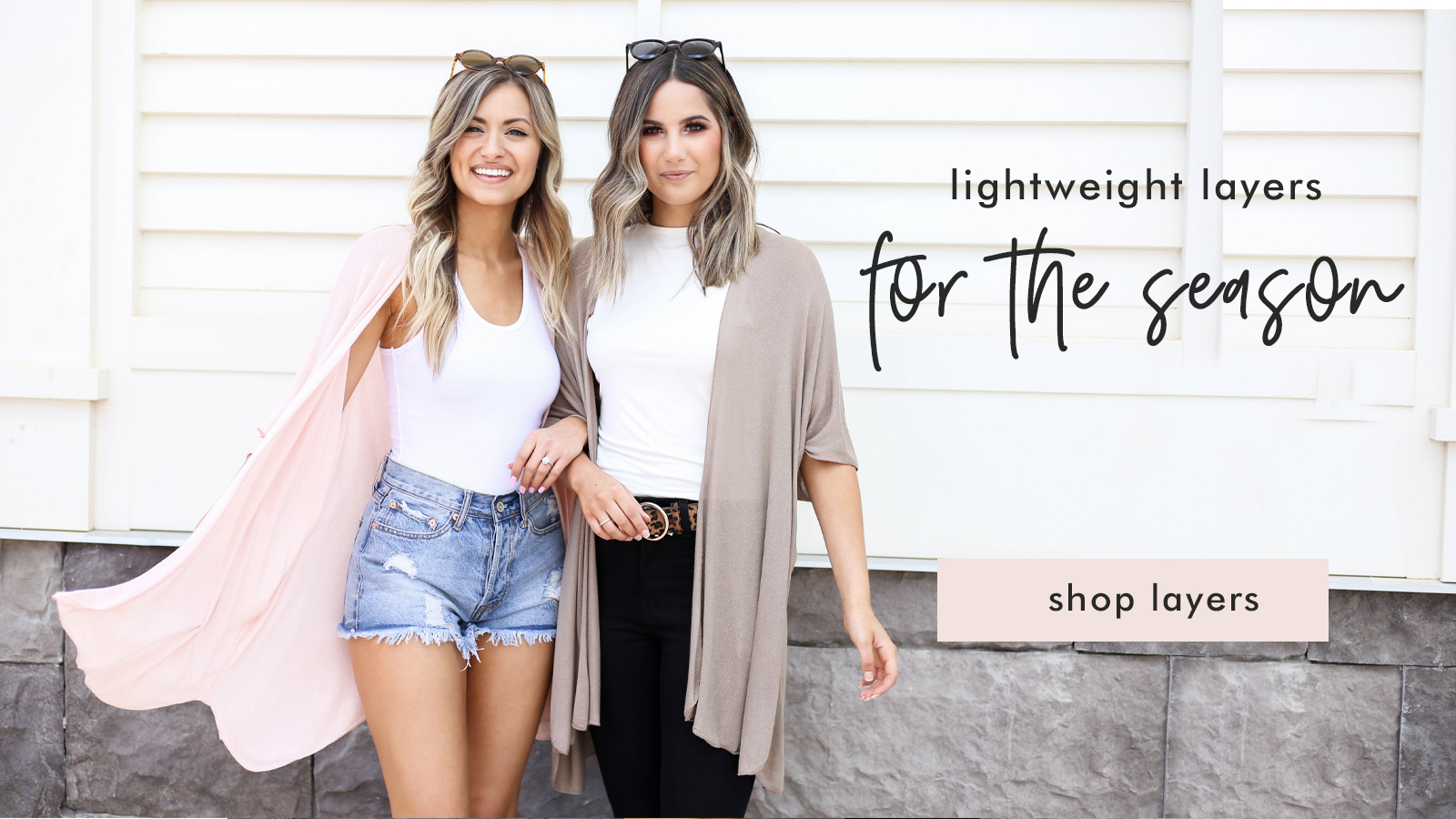 two models waering light cardigans in pink and nude
