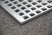 Grating is removable for easy clean-up and maintenance.
