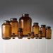 Amber Wide Mouth Packer Bottles, 4 oz with 38-400 Black Phenolic Cone Lined Cap, case/24