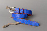 Royal Blue Caiman crocodile belt shown with optional orange X stitching and orange edge coat.