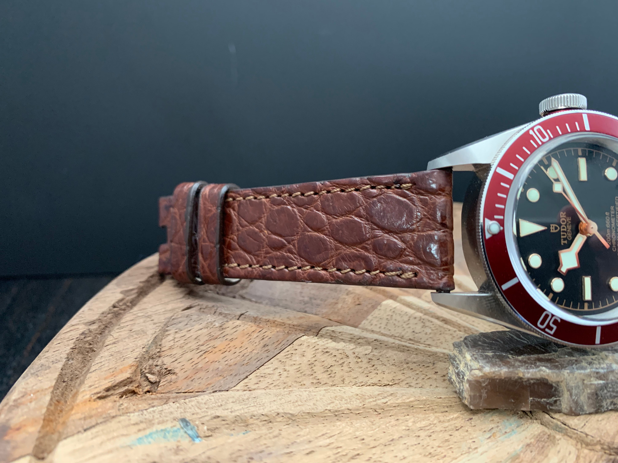 Matte Dark Cognac alligator with matching stitch shown on Tudor Black Bay  .