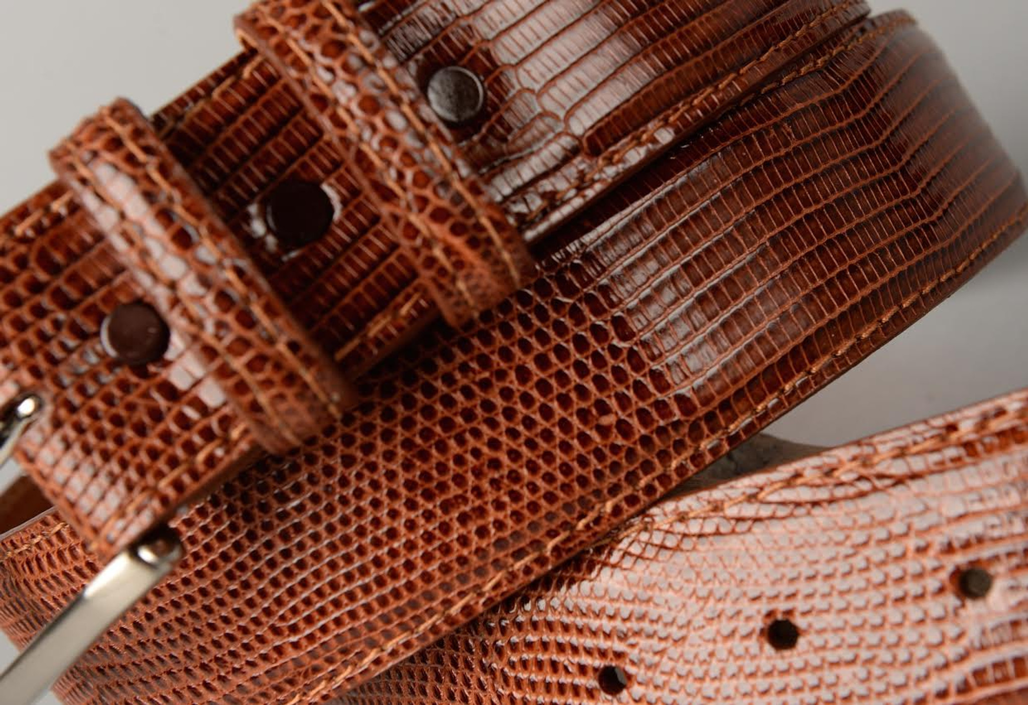 Lizard Cognac Belt shown with matching edge and stitch.