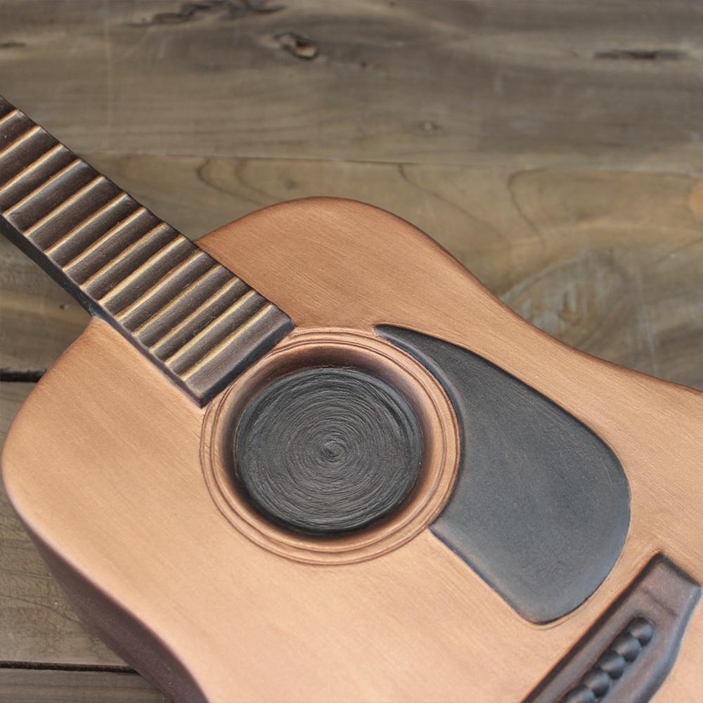 Detail photo of guitar urn