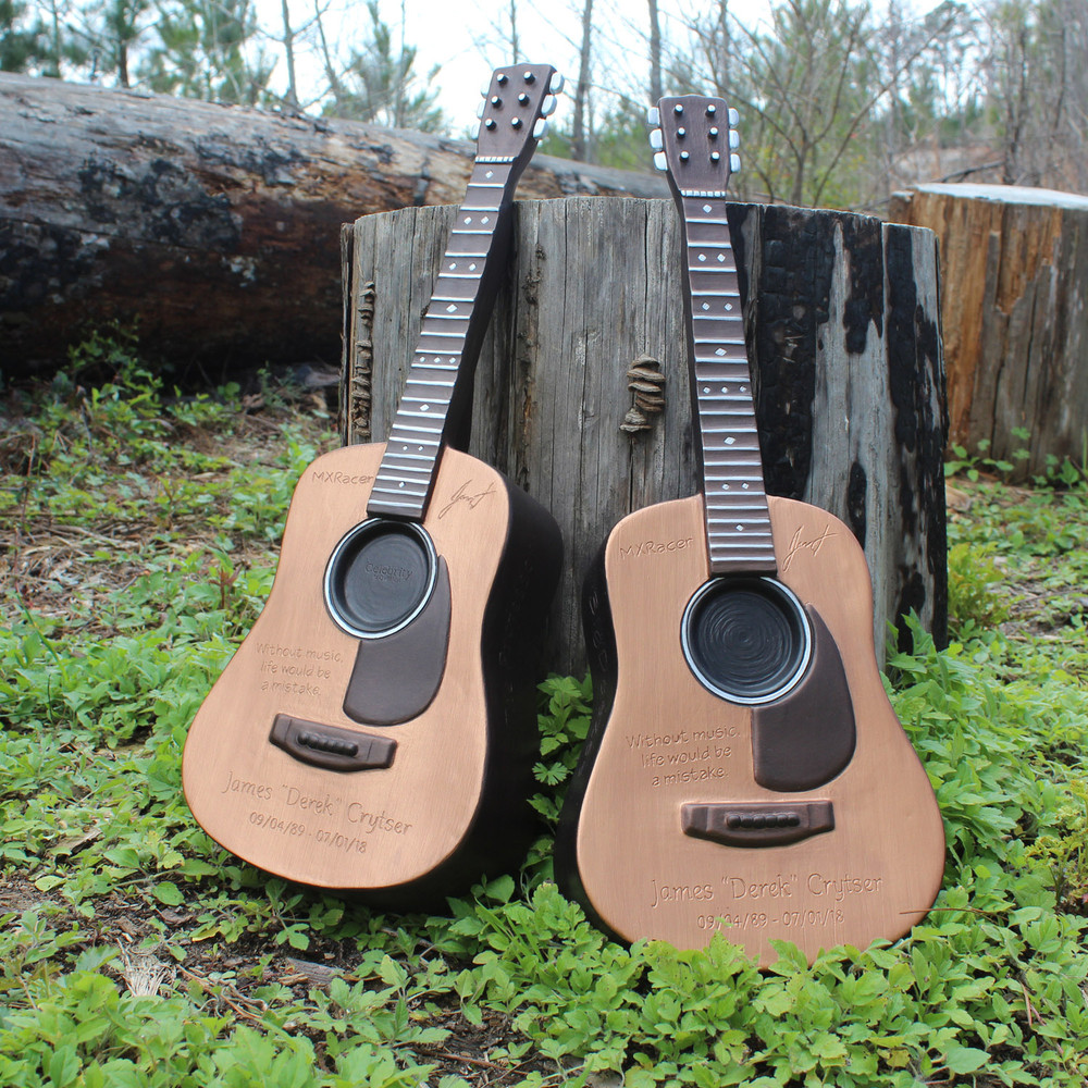 Two guitar urns together