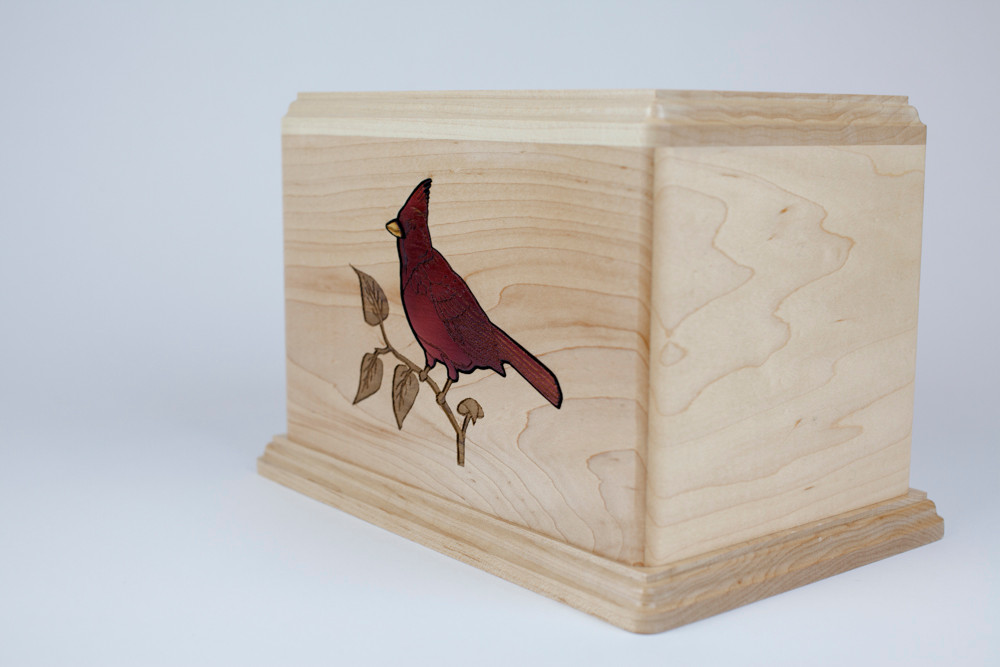 Wood inlay is set flush into the surface of the urn