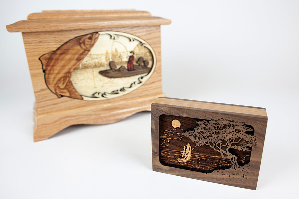Keepsake urn size comparison: Adult sized urn in the back, keepsake urn in front (Pictured with Seascape scene)