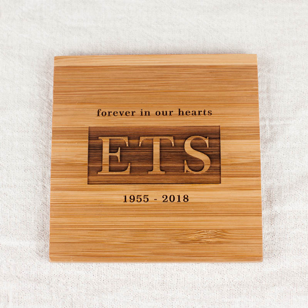 "Engraved with ""Forever in our hearts"" plus initials and dates"