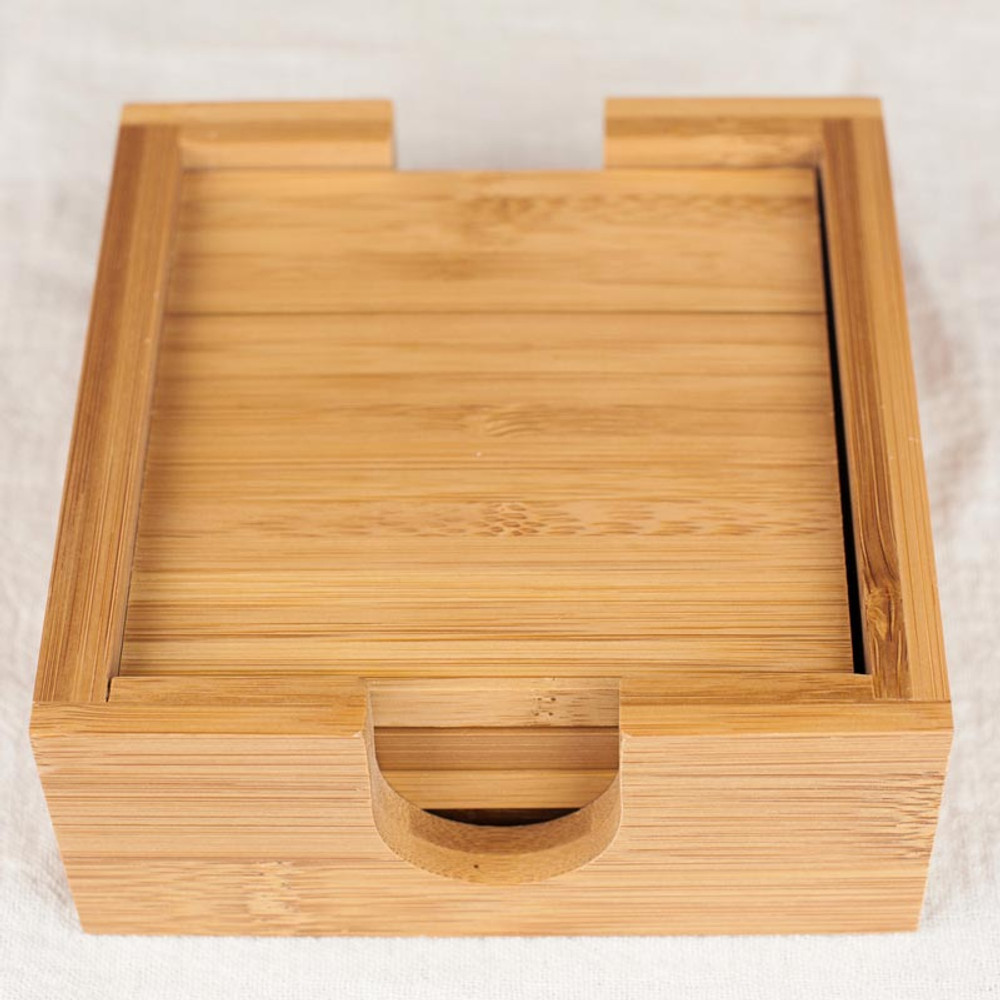 Includes matching bamboo wood coaster holder