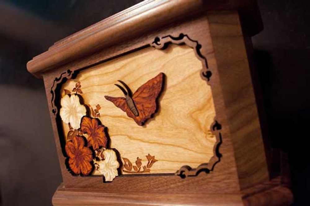 Butterfly urn: Walnut wood with engraved inlay scene